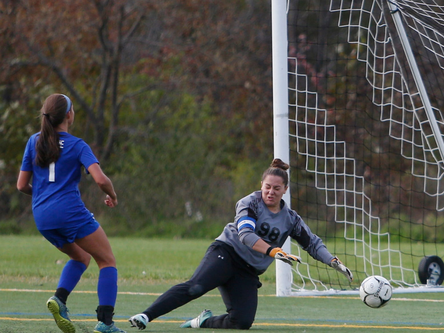 Haldane's Jade Villella shoots to score on Millbrook's Claire Martel in overtime during Wednesday's Class C regional semifinal in Freedom Plains on October 31, 2018.