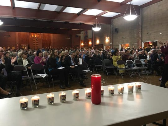 Eleven candles – one for each victim of the massacre at a Pittsburgh synagogue.– were placed on a table at a vigil at the Temple Beth-El in Poughkeepsie Wednesday.