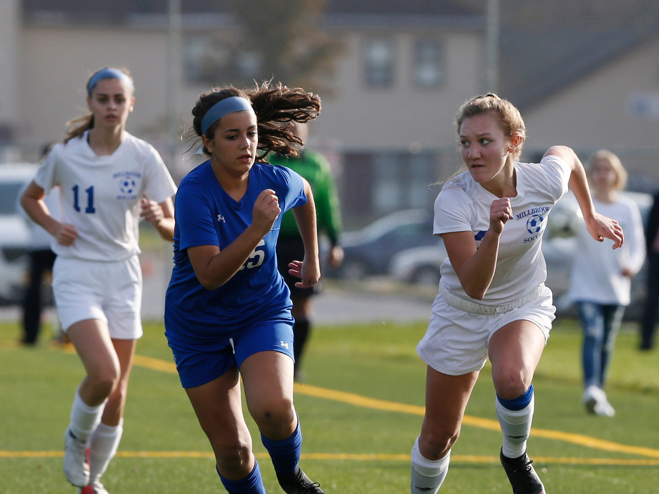 Haldane's Alexandra Ferreira and  Millbrook's Arianna Radovic  race for the ball during Wednesday's Class C regional semifinal in Freedom Plains on October 31, 2018.