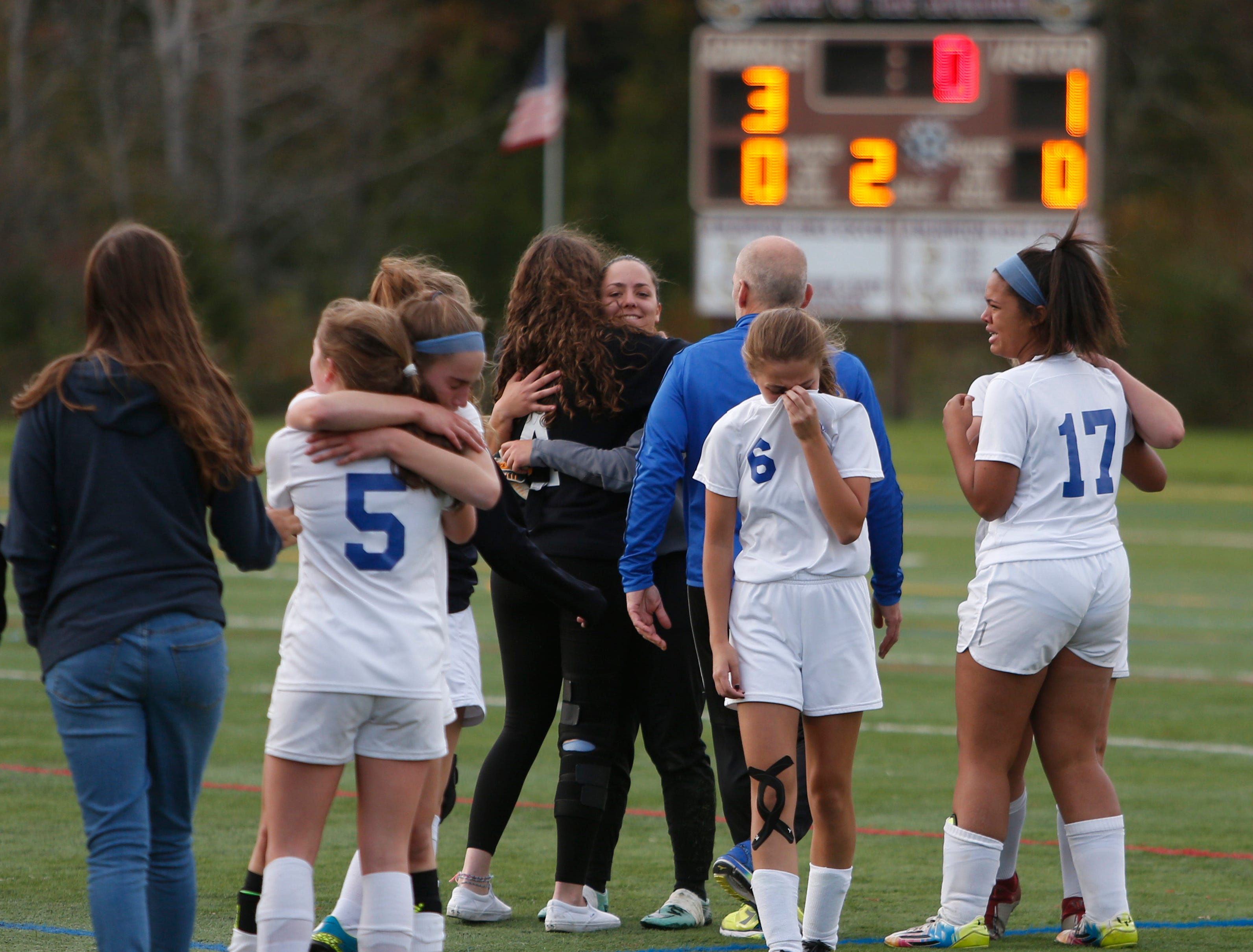 Millbrook's girls soccer team console each other following losing in Wednesday's Class C regional semifinal versus Haldane in Freedom Plains on October 31, 2018.