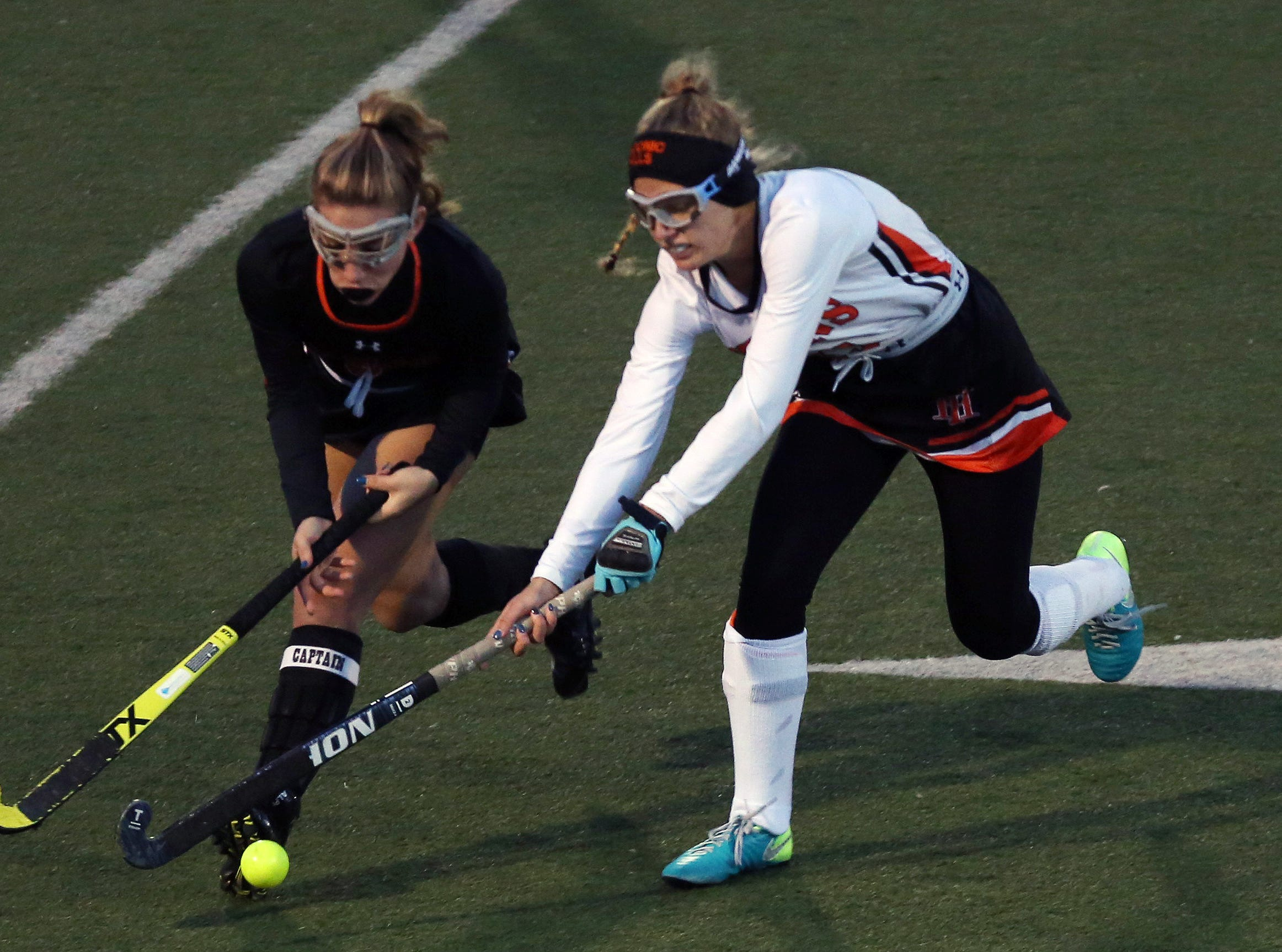 Pawling's Francesca Fleming (6) battles for ball control with Taconic Hills' Delana Bonci (13) during the Class C field hockey regional semifinal at Dietz Stadium in Kingston Oct. 30, 2018.