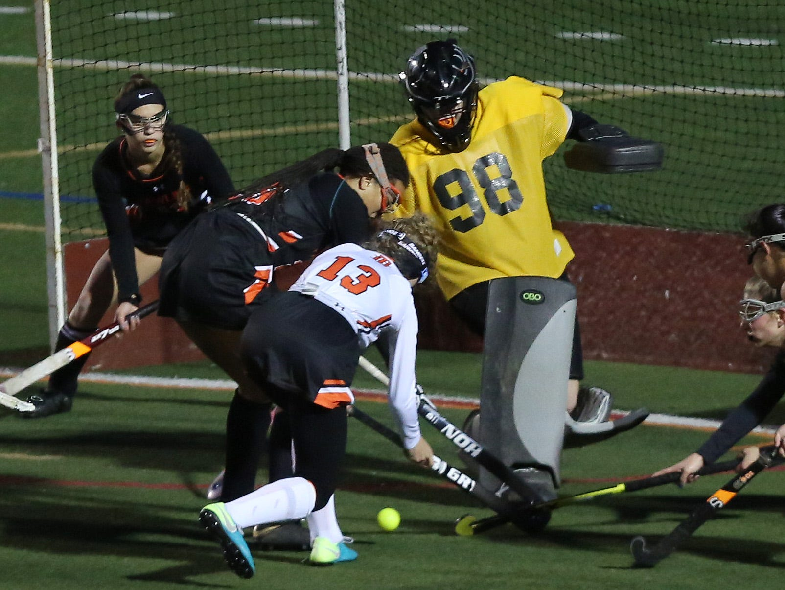 Pawling goal keeper Sara Corbi (98) stops a shot by Taconic Hills' Delana Bonci (12) during the Class C field hockey regional semifinal at Dietz Stadium in Kingston Oct. 30, 2018.