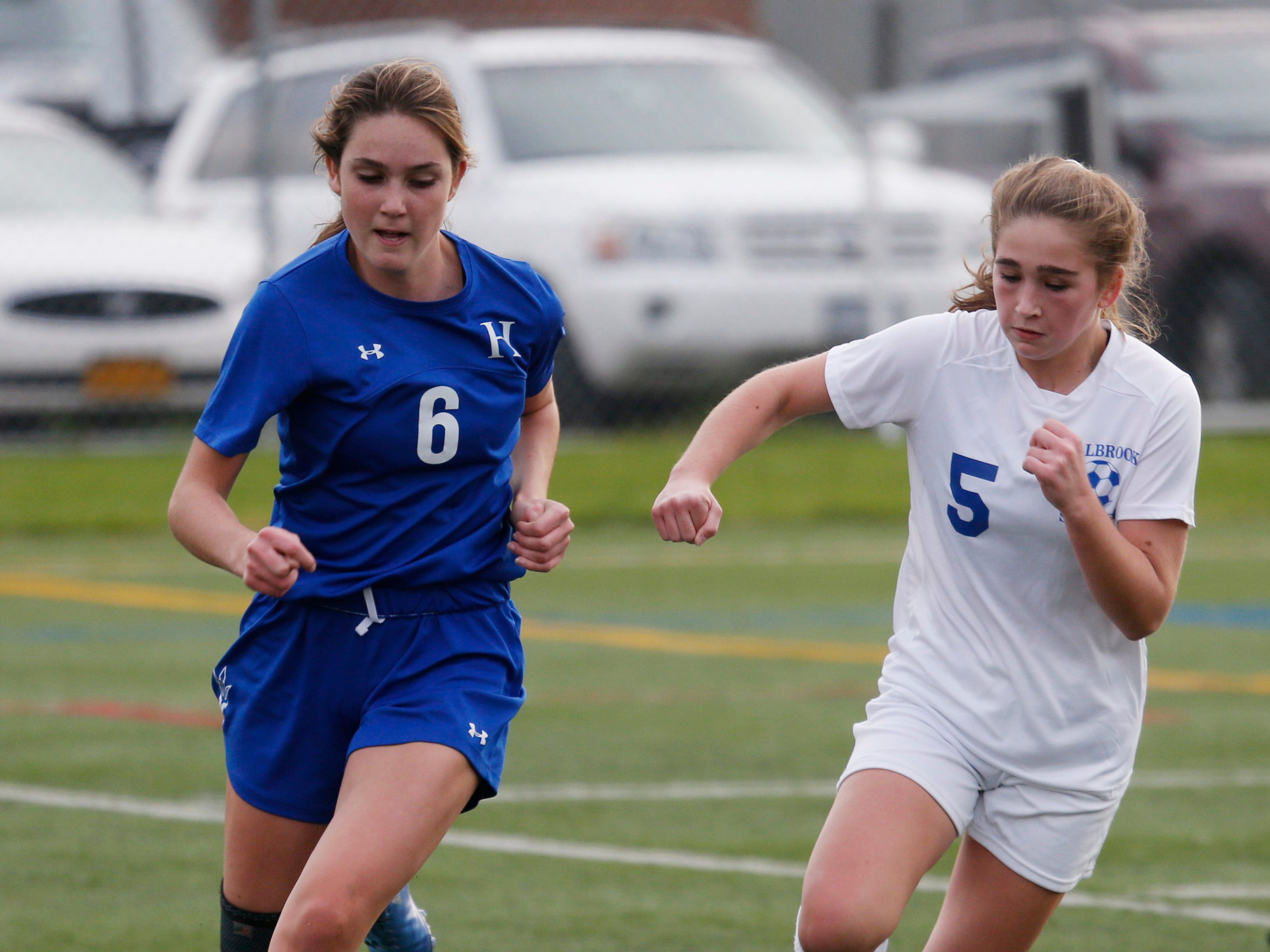 Haldane's Maura Kane-Seitz and Millbrook's Eleeana Francia race for the ball during Wednesday's Class C regional semifinal in Freedom Plains on October 31, 2018.