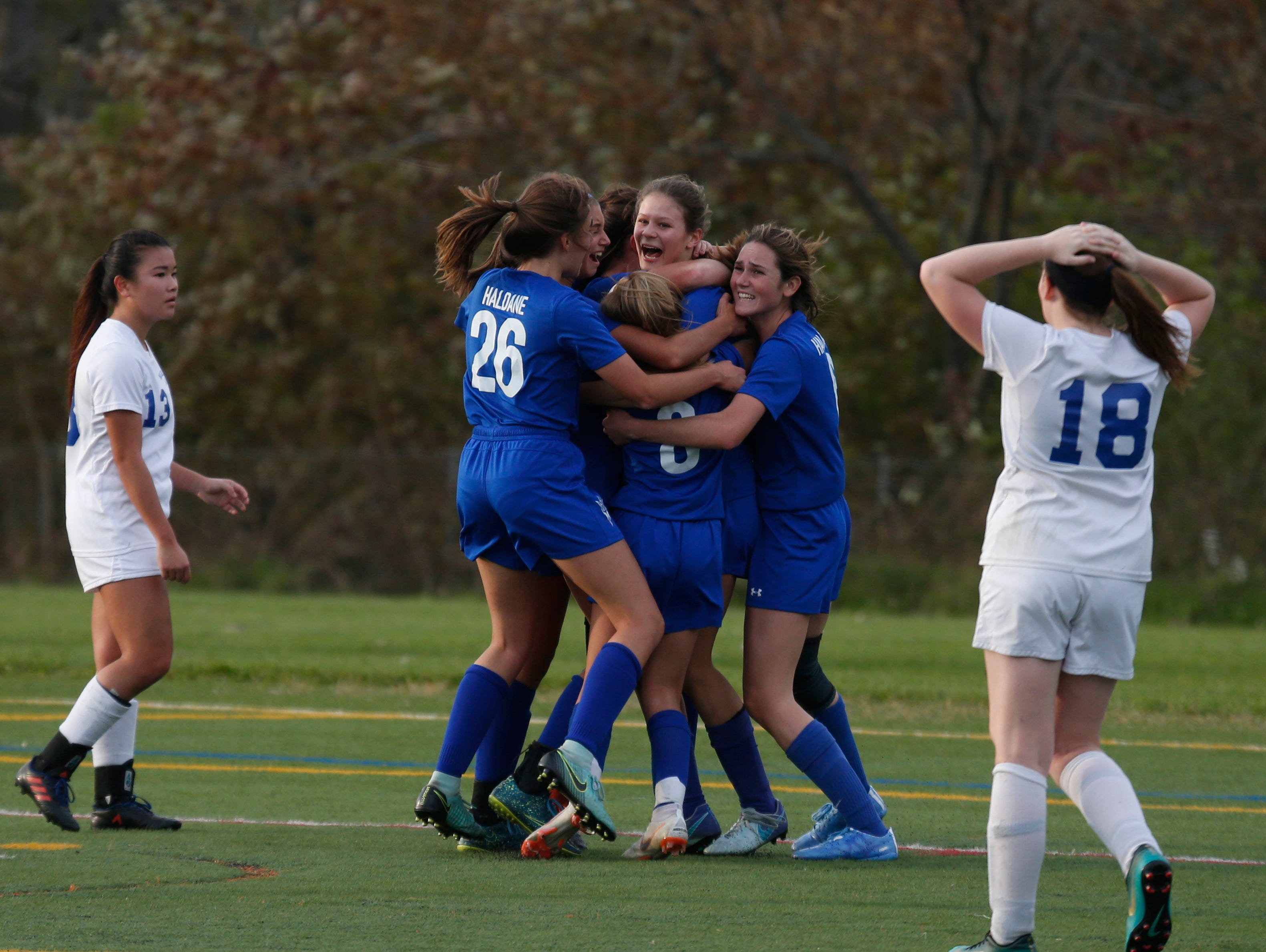 Haldane celebrates scoring a goal to tie the game during Wednesday's Class C regional semifinal over Millbrook in Freedom Plains on October 31, 2018.