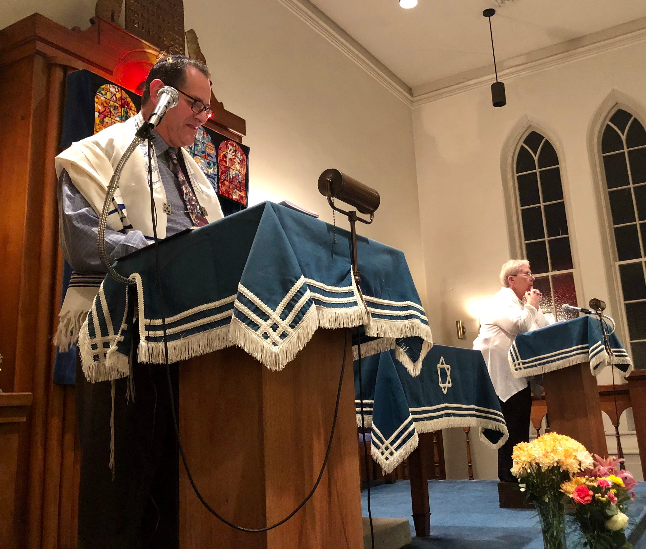 Rabbi Ilan Pardo (left) speaks to the audience at Congregation Sons of Israel in Chambersburg during a memorial service the evening of Tuesday, Oct. 30. The event was held to honor 11 Jewish people who were killed in a shooting in Pittsburgh a few days earlier. Also pictured: Lynne Newman (right), a member of the congregation.