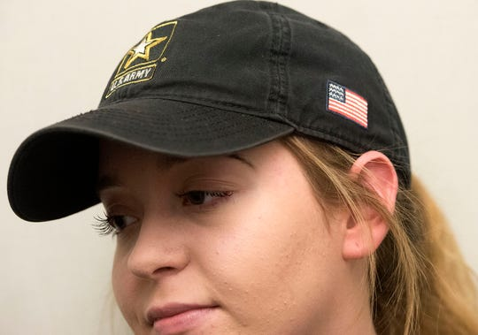 Breana Stine, Waynesboro, sports U.S. Army hat during an interview with reporters, Wednesday, October 31, 2018. Stine will soon head to Fort Benning miltary base, Georgia, to train in infantry.