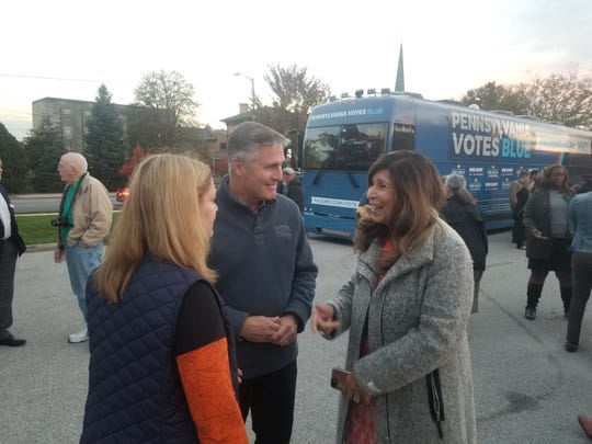 10th District Democratic candidate George Scott shares a laugh with Judith Higgins and Delma Rivera-Lytle during a stop on the PA Votes Blue bus tour at York City's Trunk or Treat event.