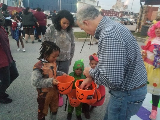 During a stop on the PA Votes Blue bus tour, Sen. Bob Casey  hands out candy to children at York City's Trunk or Treat event.