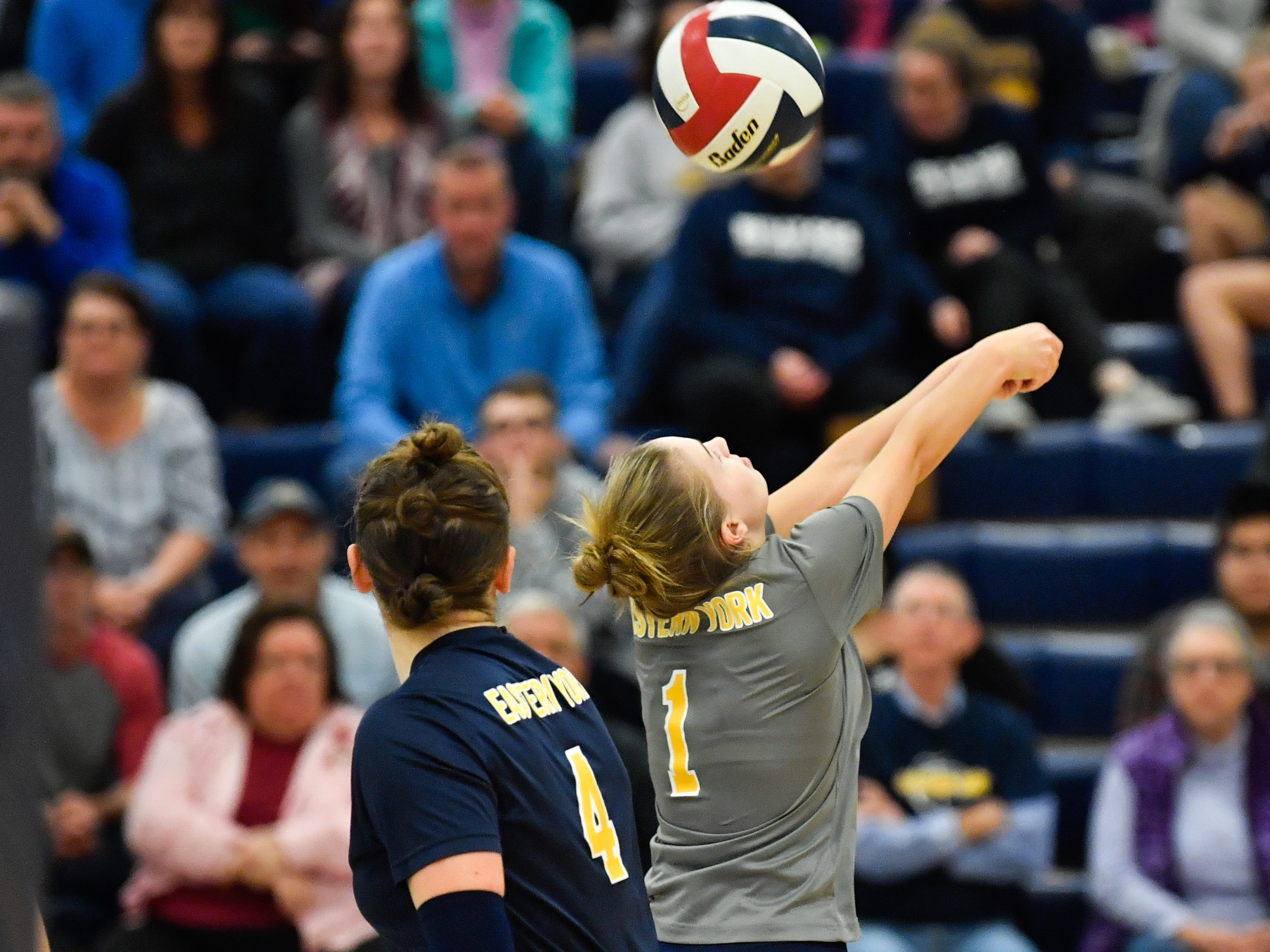 Olivia Koicuba (1) of Eastern York bumps the ball during the District 3 Class 3A girls' volleyball quarterfinals between West York and Eastern York at West York High School, October 30, 2018. The Bulldogs defeated the Golden Knights 3-0.