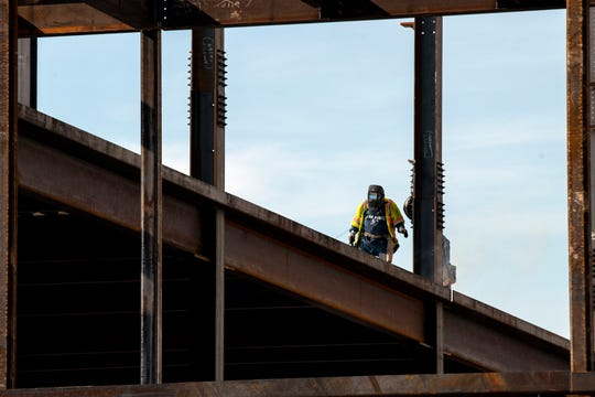 A wielder works on the roof of the outpatient center, still under construction, at UPMC Pinnacle Memorial hospital, in West Manchester Township. The hospital is expected to open in August of 2019.