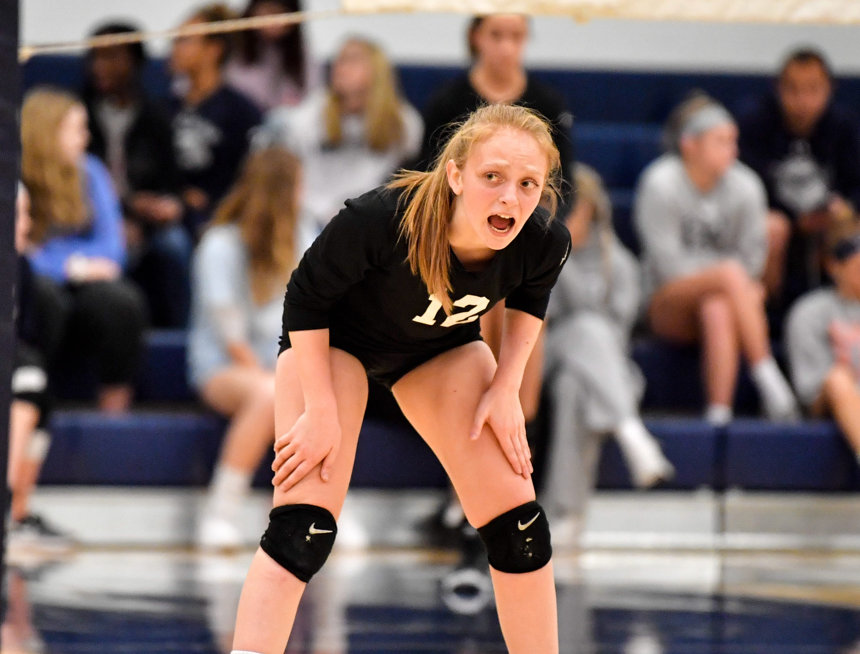 Lauren Guyer (12) motivates her team during the District 3 Class 3A girls' volleyball quarterfinals between Dover and York Suburban at West York High School, October 30, 2018. The Eagles defeated the Trojans 3-2.