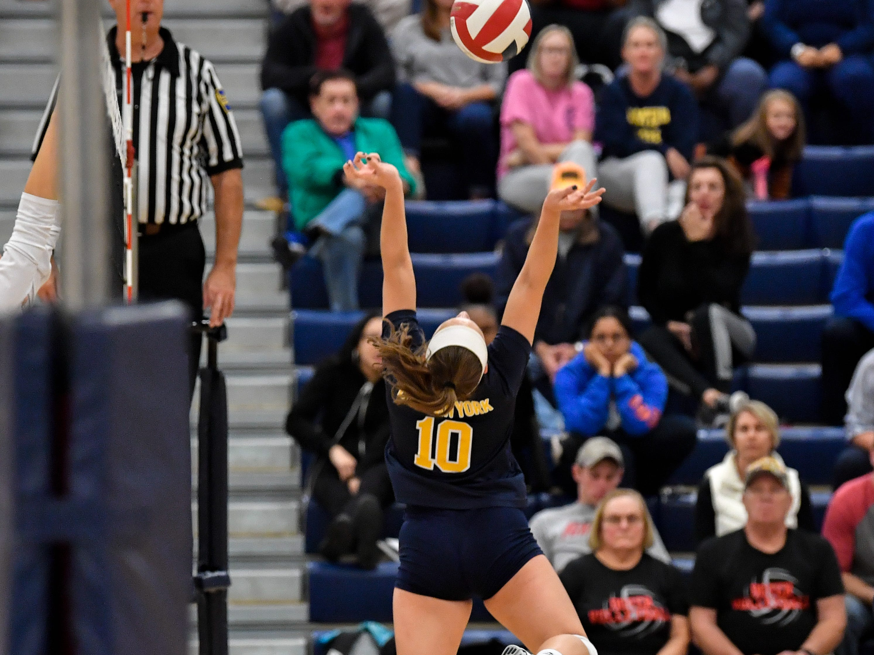 Katie Lehman (10) sets the ball during the District 3 Class 3A girls' volleyball quarterfinals between West York and Eastern York at West York High School, October 30, 2018. The Bulldogs defeated the Golden Knights 3-0.