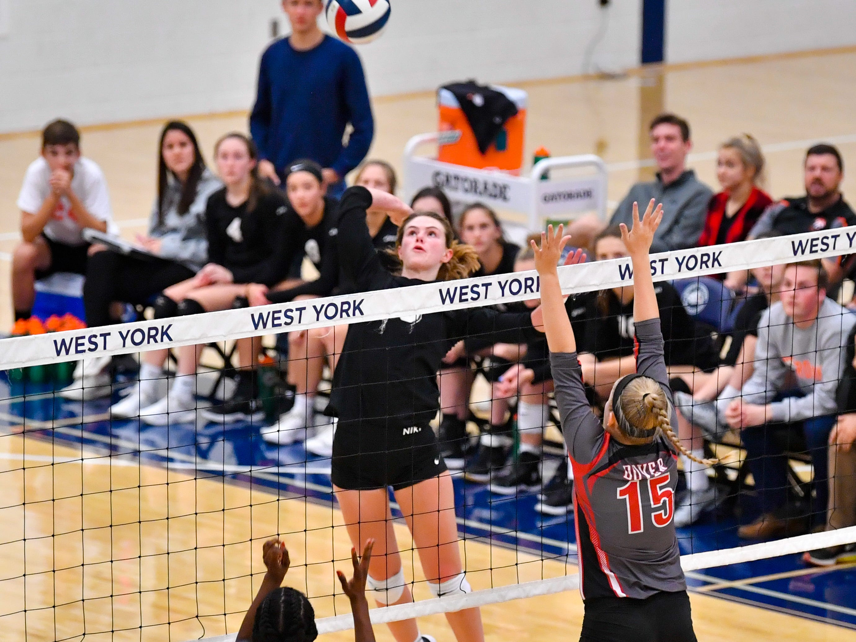 York Suburban's Elizabeth Mooney (13) rises up to spike the ball during the District 3 Class 3A girls' volleyball quarterfinals between Dover and York Suburban at West York High School, October 30, 2018. The Eagles defeated the Trojans 3-2.