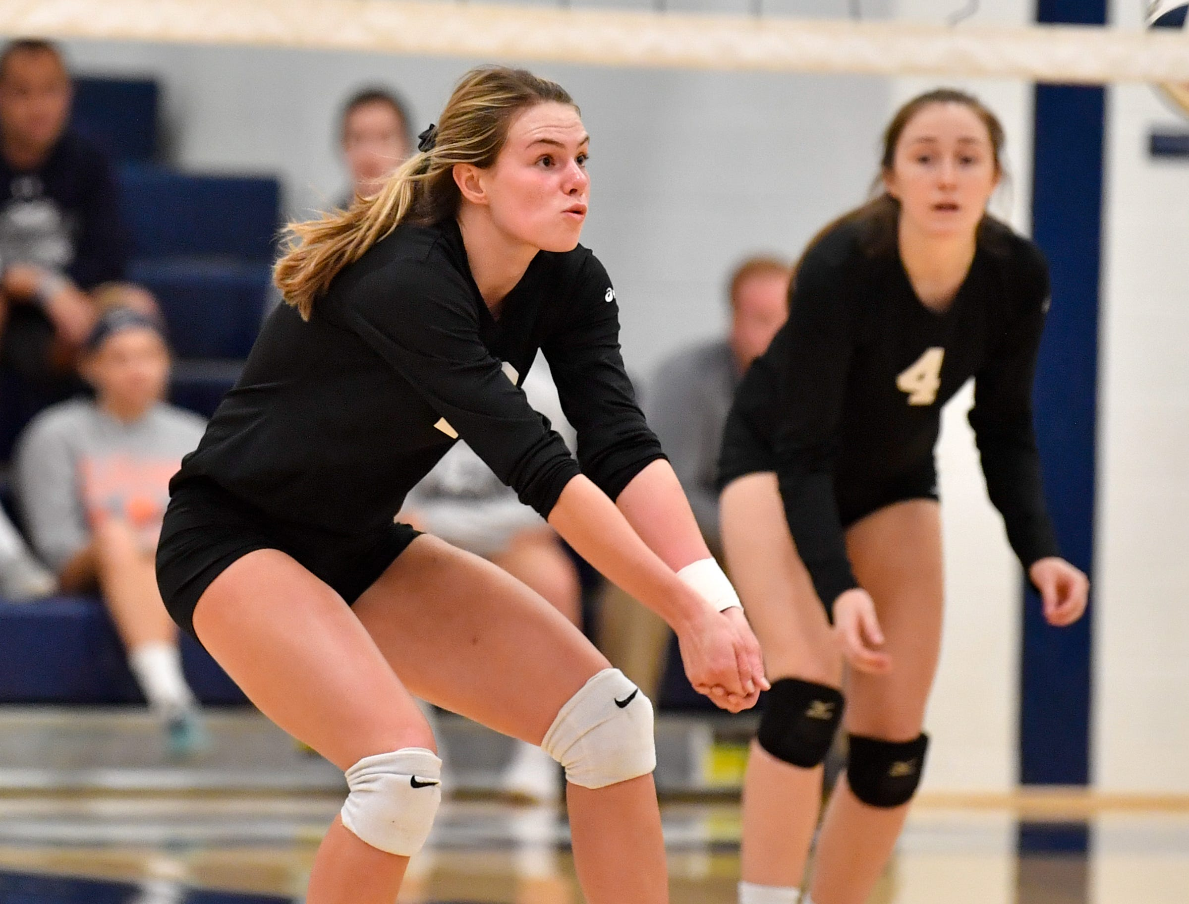 Elizabeth Mooney (13) bumps the ball during the District 3 Class 3A girls' volleyball quarterfinals between Dover and York Suburban at West York High School, October 30, 2018. The Eagles defeated the Trojans 3-2.