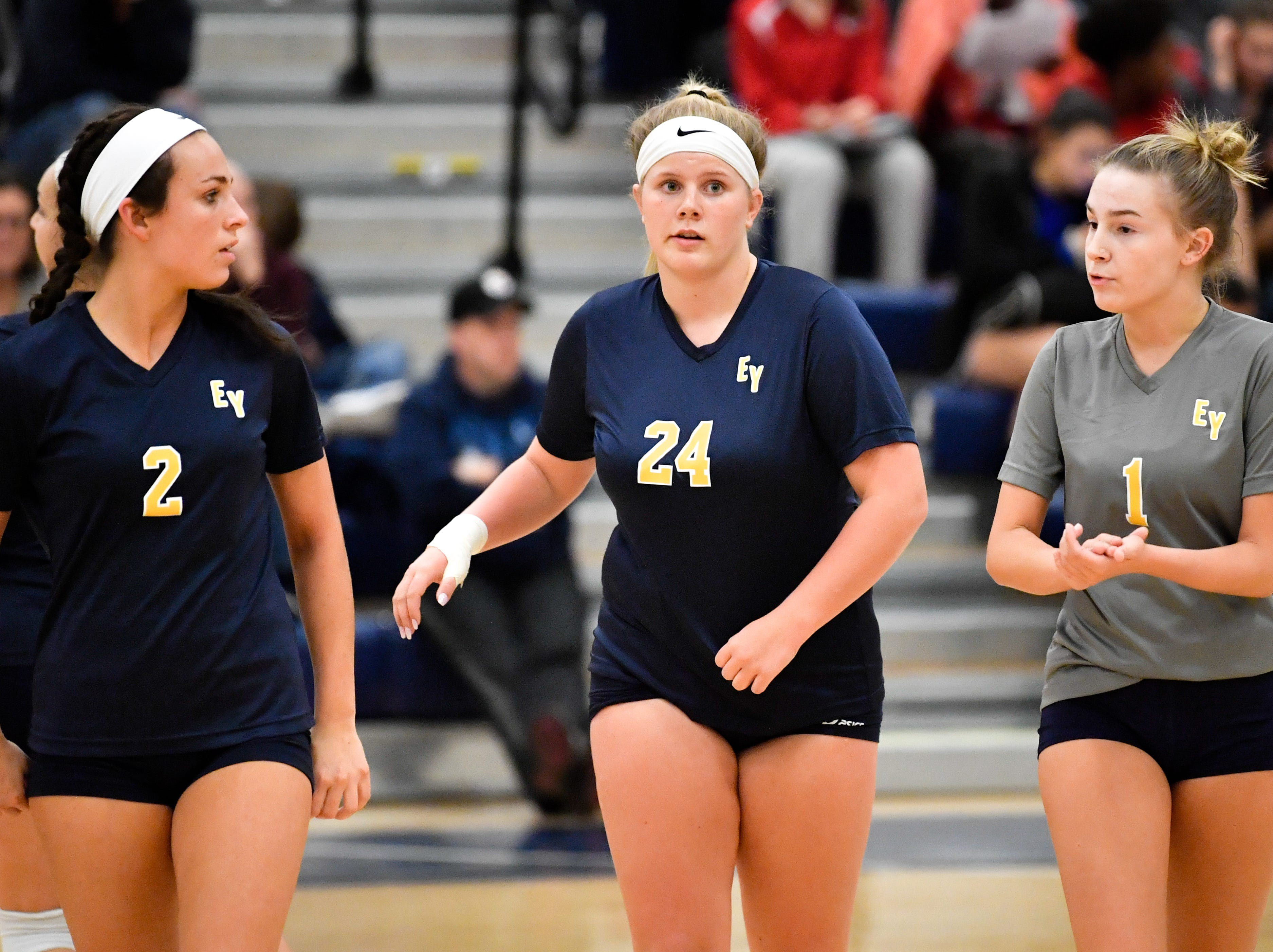 Morgan Dobbeck (2), Morgan Winter (24) and Olivia Koicuba (1) head to the bench for a timeout during the District 3 Class 3A girls' volleyball quarterfinals between West York and Eastern York at West York High School, October 30, 2018. The Bulldogs defeated the Golden Knights 3-0.