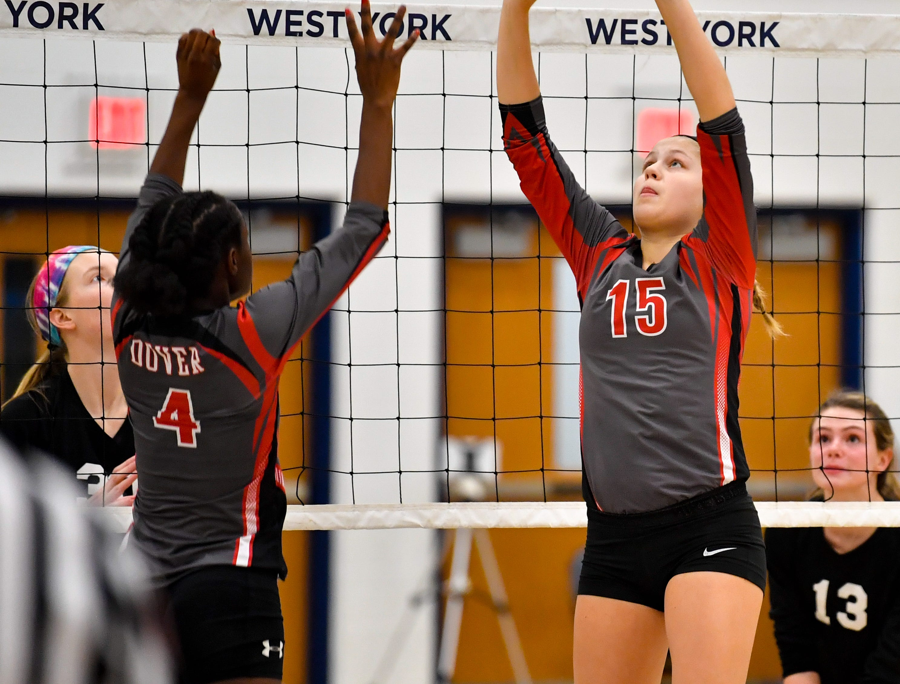 Abby Diehl (15) of Dover sets Frankie White (4) during the District 3 Class 3A girls' volleyball quarterfinals between Dover and York Suburban at West York High School, October 30, 2018. The Eagles defeated the Trojans 3-2.