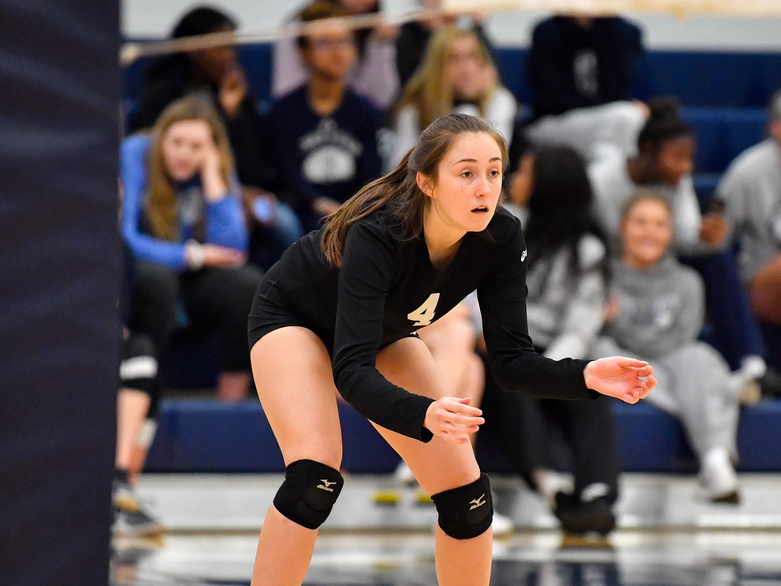 Maia Carney (4) prepares to receive the serve during the District 3 Class 3A girls' volleyball quarterfinals between Dover and York Suburban at West York High School, October 30, 2018. The Eagles defeated the Trojans 3-2.