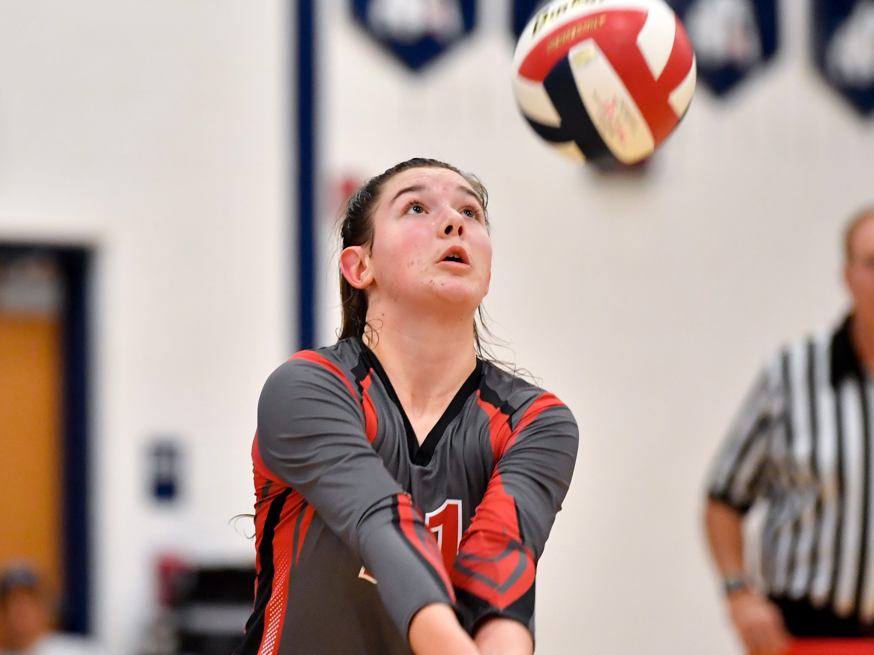 Emma Davis (21) controls the ball during the District 3 Class 3A girls' volleyball quarterfinals between Dover and York Suburban at West York High School, October 30, 2018. The Eagles defeated the Trojans 3-2.