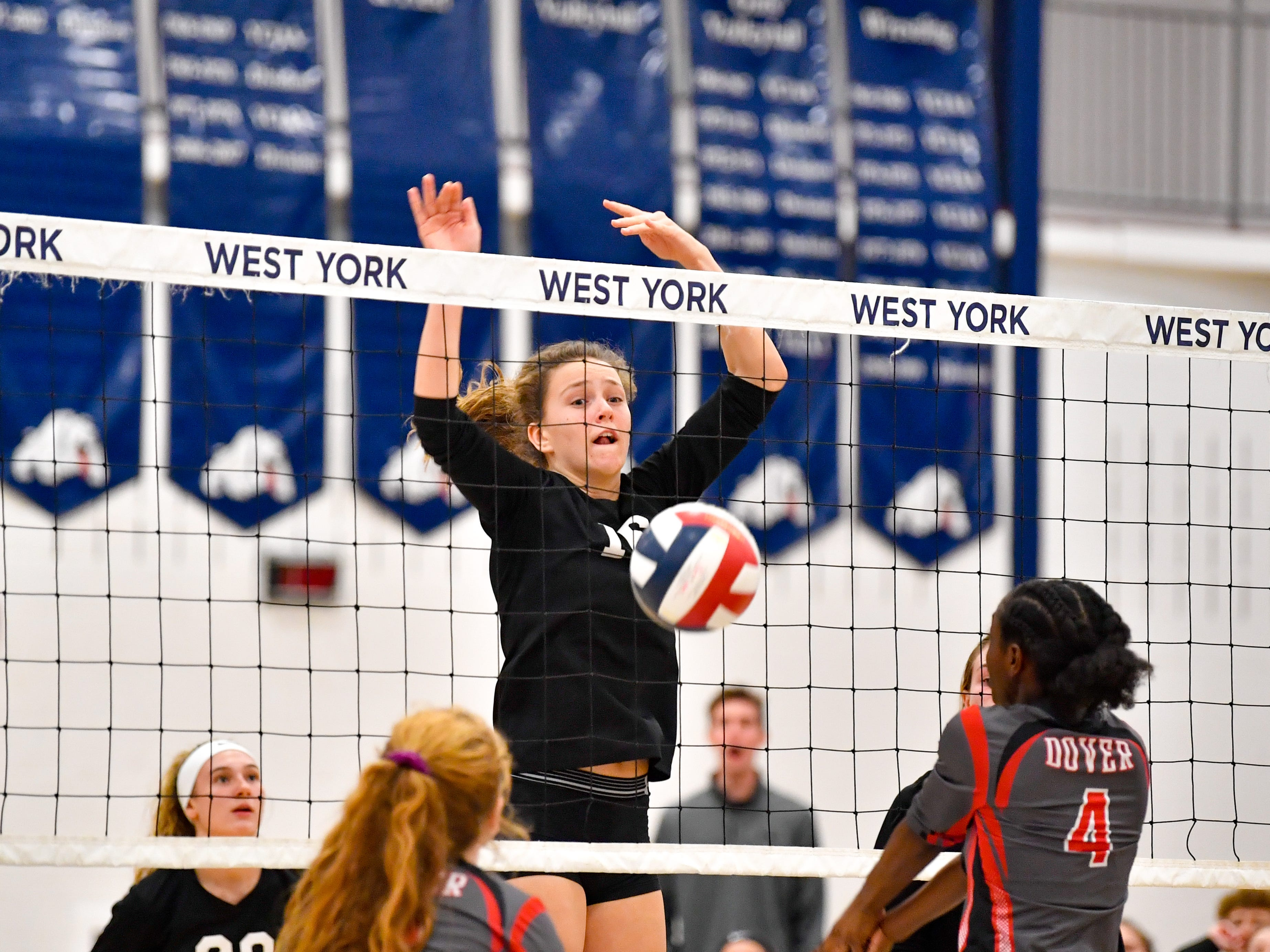 Maddison Perring (16) blocks the ball during the District 3 Class 3A girls' volleyball quarterfinals between Dover and York Suburban at West York High School, October 30, 2018. The Eagles defeated the Trojans 3-2.