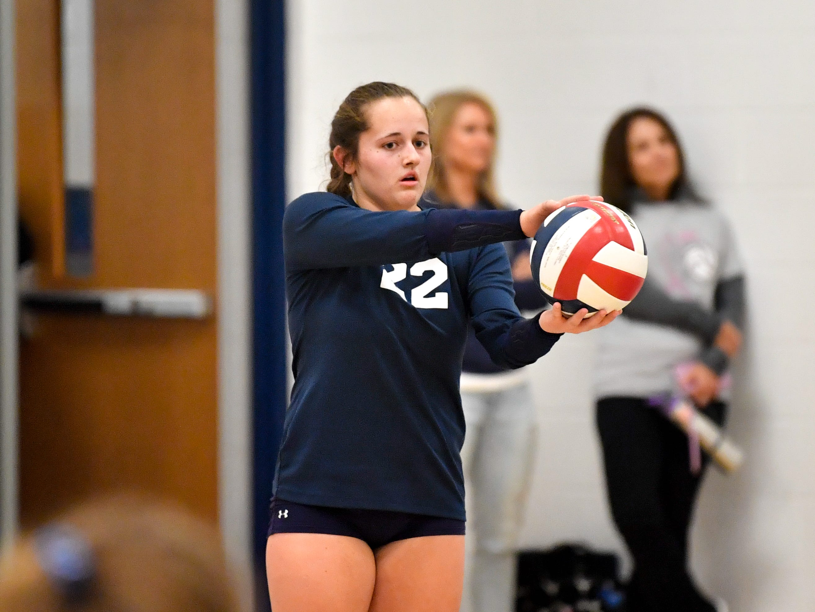 Kambrie Hepler (22) prepares to serve during the District 3 Class 3A girls' volleyball quarterfinals between West York and Eastern York at West York High School, October 30, 2018. The Bulldogs defeated the Golden Knights 3-0.