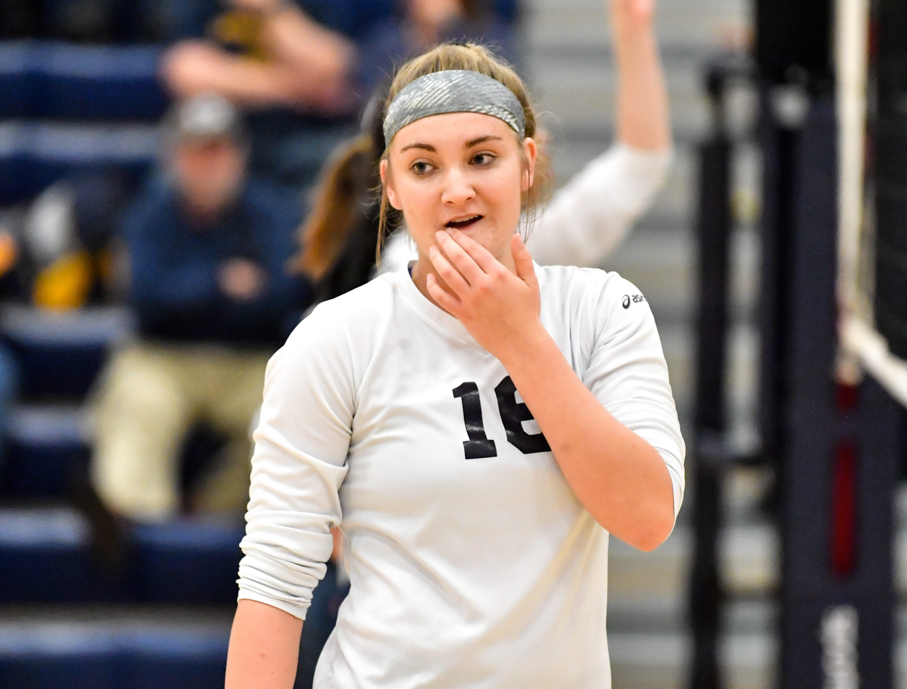 Georgianna Kahley (16) listens to her coach during the District 3 Class 3A girls' volleyball quarterfinals between West York and Eastern York at West York High School, October 30, 2018. The Bulldogs defeated the Golden Knights 3-0.