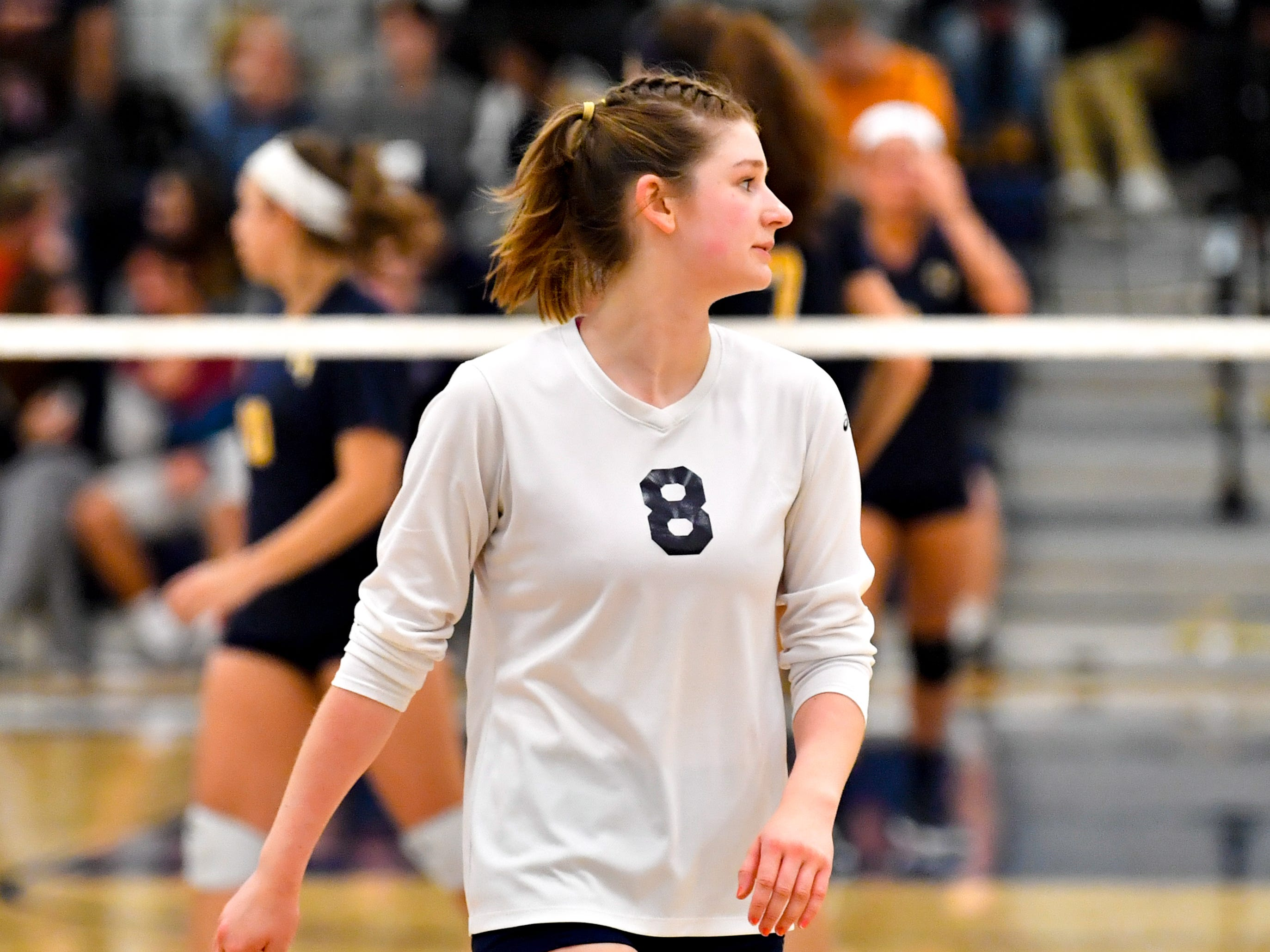 Julia Rill (8) walks to the huddle during the District 3 Class 3A girls' volleyball quarterfinals between West York and Eastern York at West York High School, October 30, 2018. The Bulldogs defeated the Golden Knights 3-0.