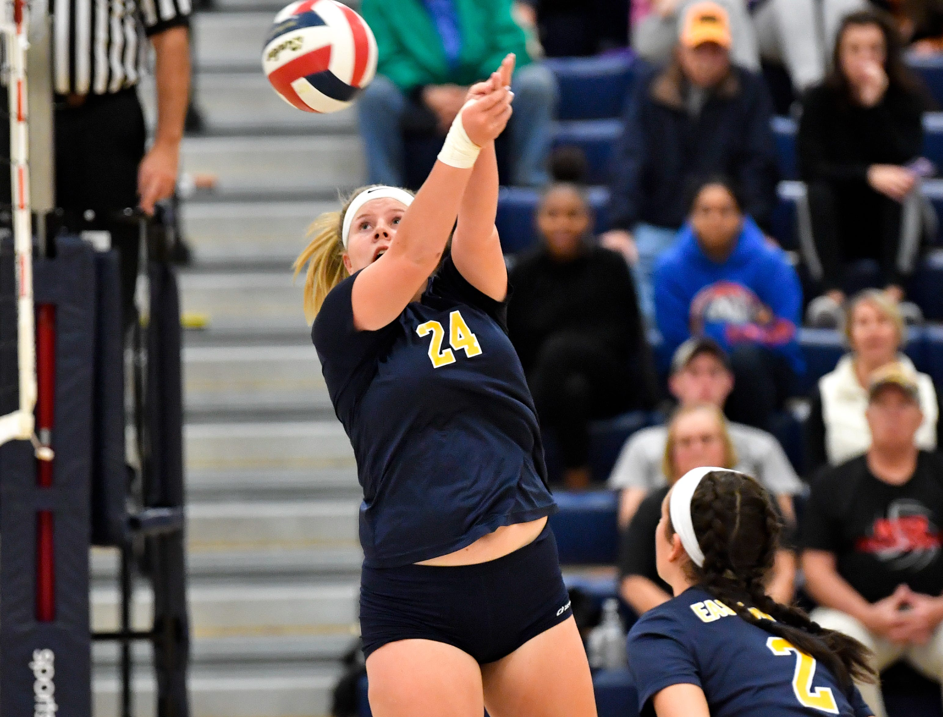 Morgan Winter (24) hits the ball over during the District 3 Class 3A girls' volleyball quarterfinals between West York and Eastern York at West York High School, October 30, 2018. The Bulldogs defeated the Golden Knights 3-0.