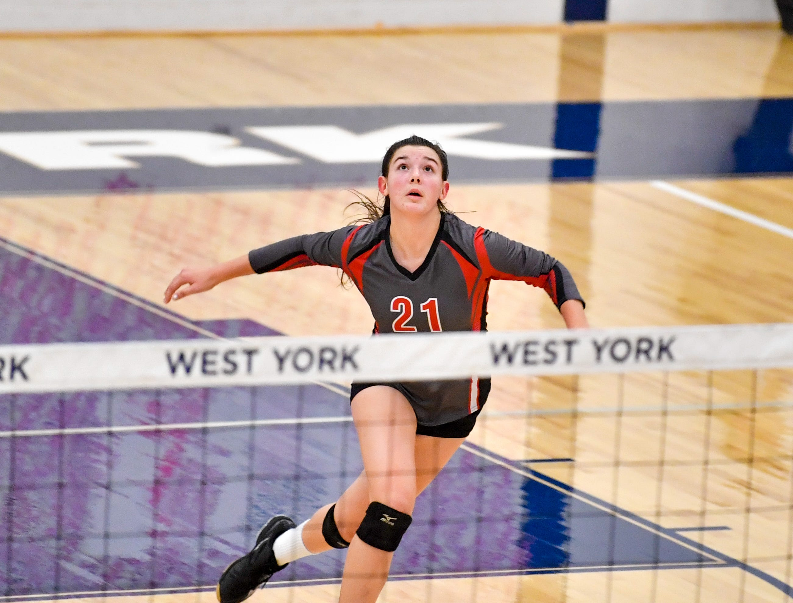 Emma Davis (21) tracks the ball during the District 3 Class 3A girls' volleyball quarterfinals between Dover and York Suburban at West York High School, October 30, 2018. The Eagles defeated the Trojans 3-2.
