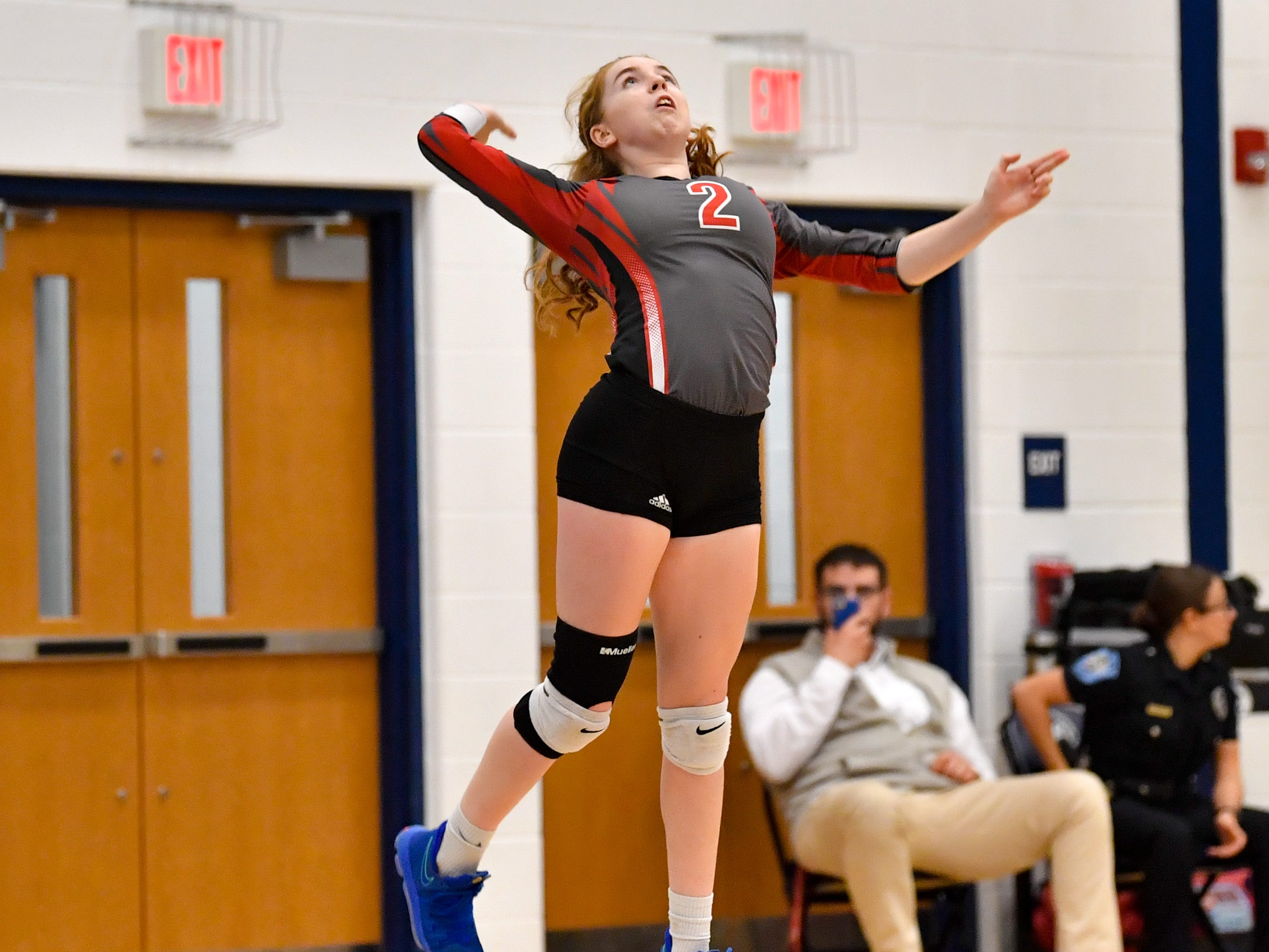 Chayce Hoffman (2) performs a jump serve during the District 3 Class 3A girls' volleyball quarterfinals between Dover and York Suburban at West York High School, October 30, 2018. The Eagles defeated the Trojans 3-2.
