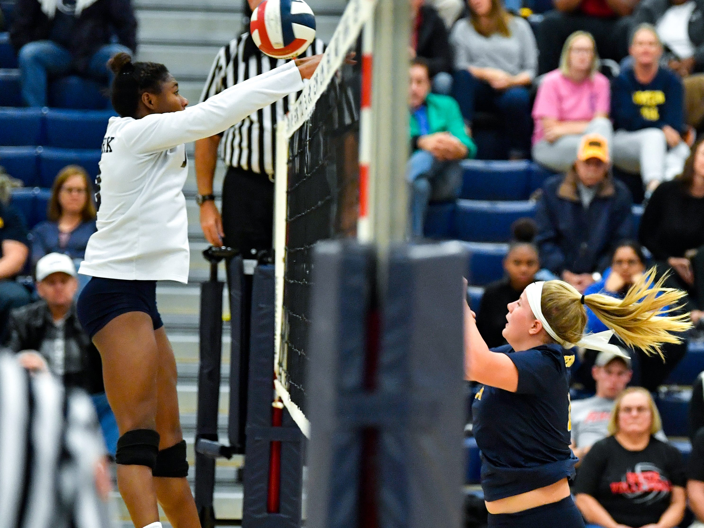 Tesia Thomas (19) tries to block the spike during the District 3 Class 3A girls' volleyball quarterfinals between West York and Eastern York at West York High School, October 30, 2018. The Bulldogs defeated the Golden Knights 3-0.