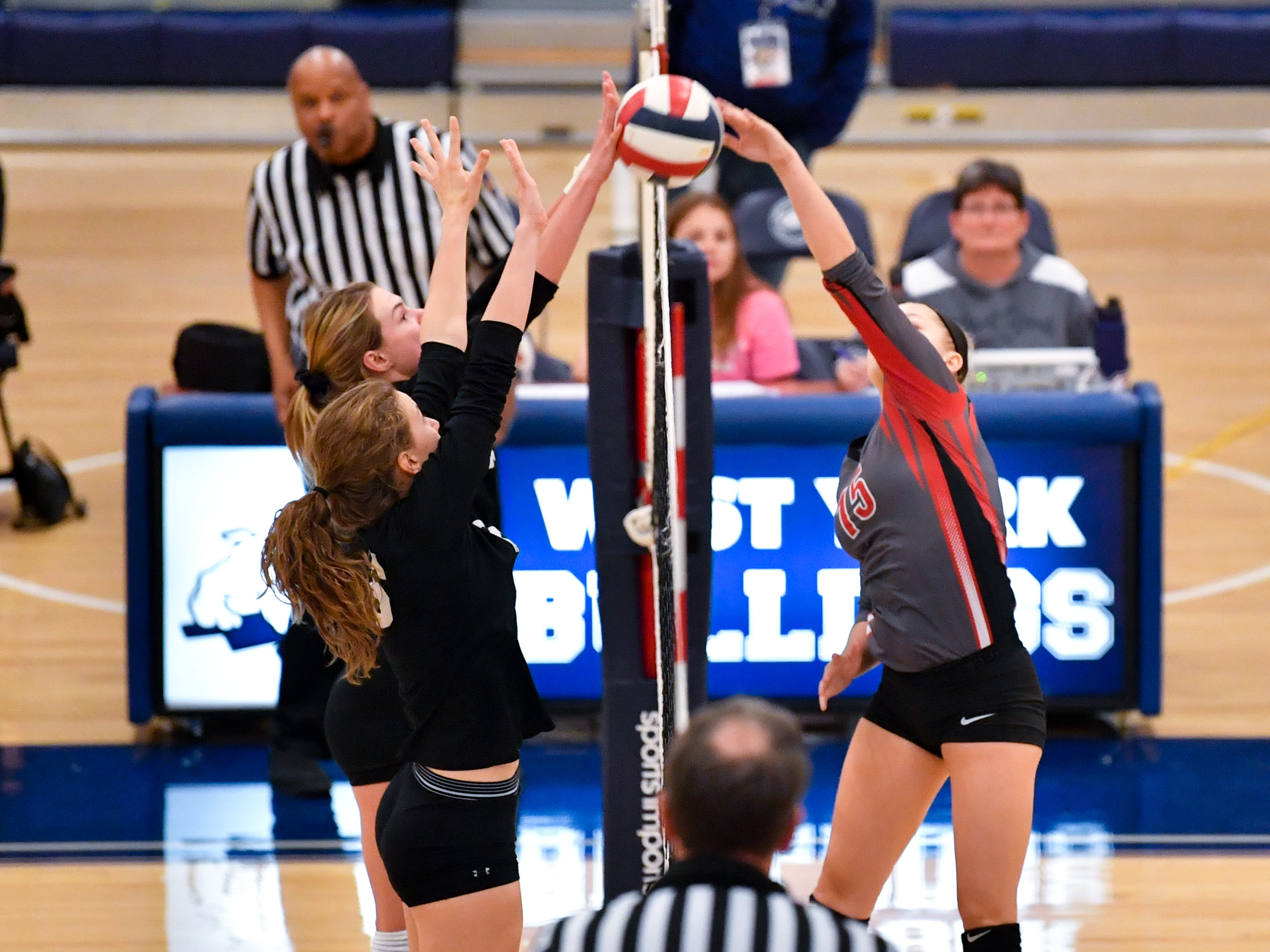York Suburban blocks the ball during the District 3 Class 3A girls' volleyball quarterfinals between Dover and York Suburban at West York High School, October 30, 2018. The Eagles defeated the Trojans 3-2.