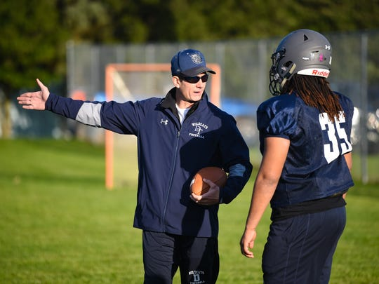 Pennsylvania Auditor General Eugene DePasquale is an assistant coach for Dallastown football. He describes how to run a play at practice, October 17, 2018.