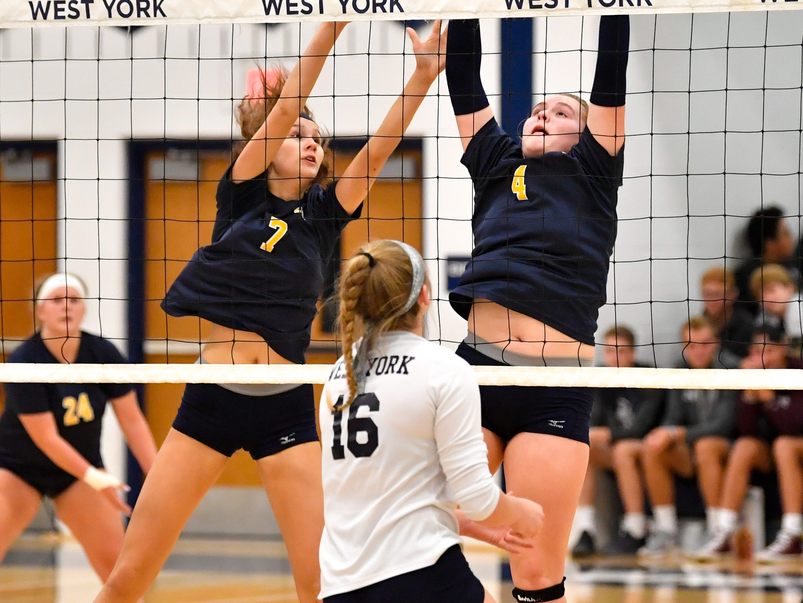 Abby Smith (7) and Sarah Moore (4) try to block the ball during the District 3 Class 3A girls' volleyball quarterfinals between West York and Eastern York at West York High School, October 30, 2018. The Bulldogs defeated the Golden Knights 3-0.