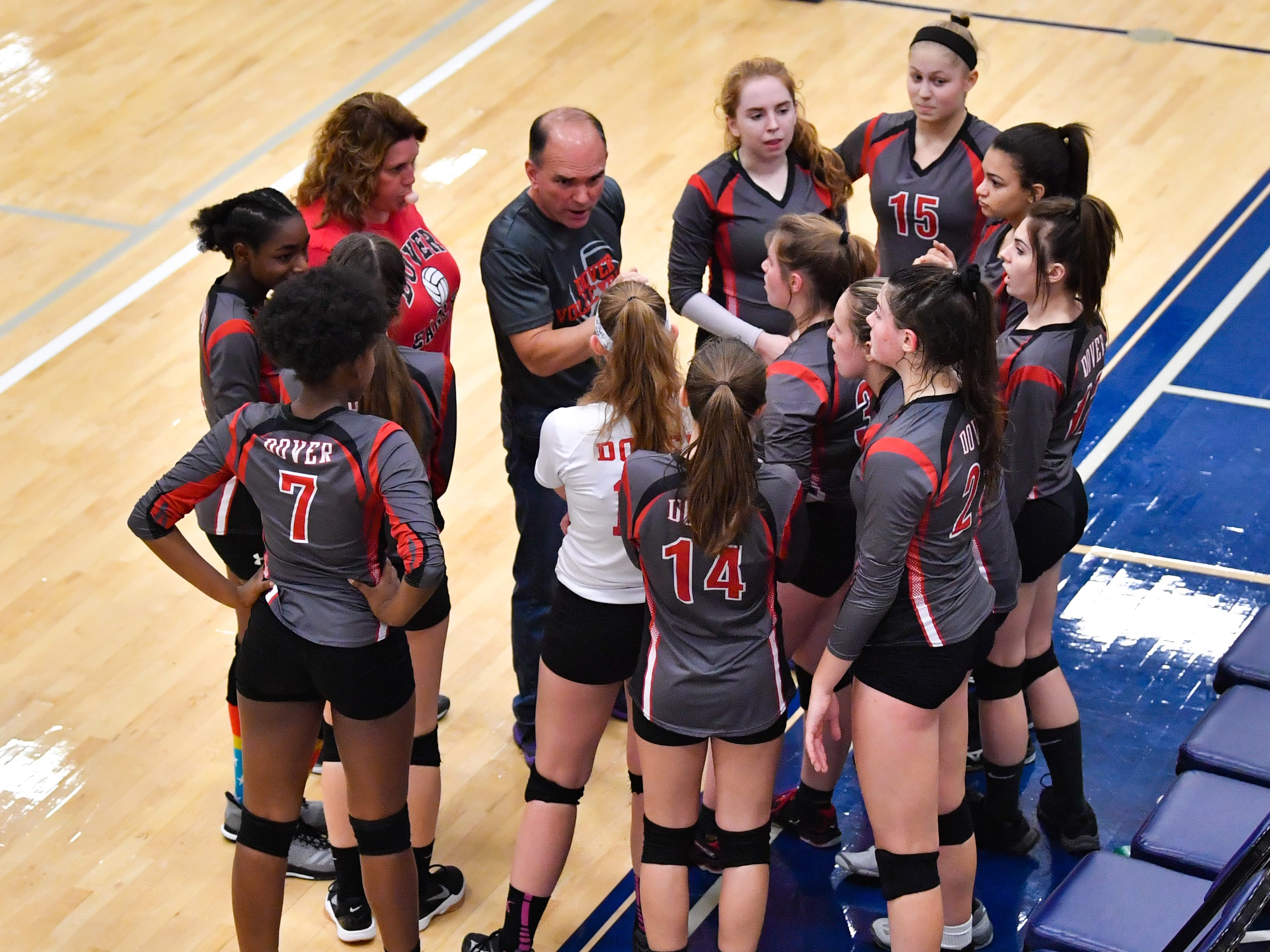 Dover discusses their next plan of attack during the District 3 Class 3A girls' volleyball quarterfinals between Dover and York Suburban at West York High School, October 30, 2018. The Eagles defeated the Trojans 3-2.