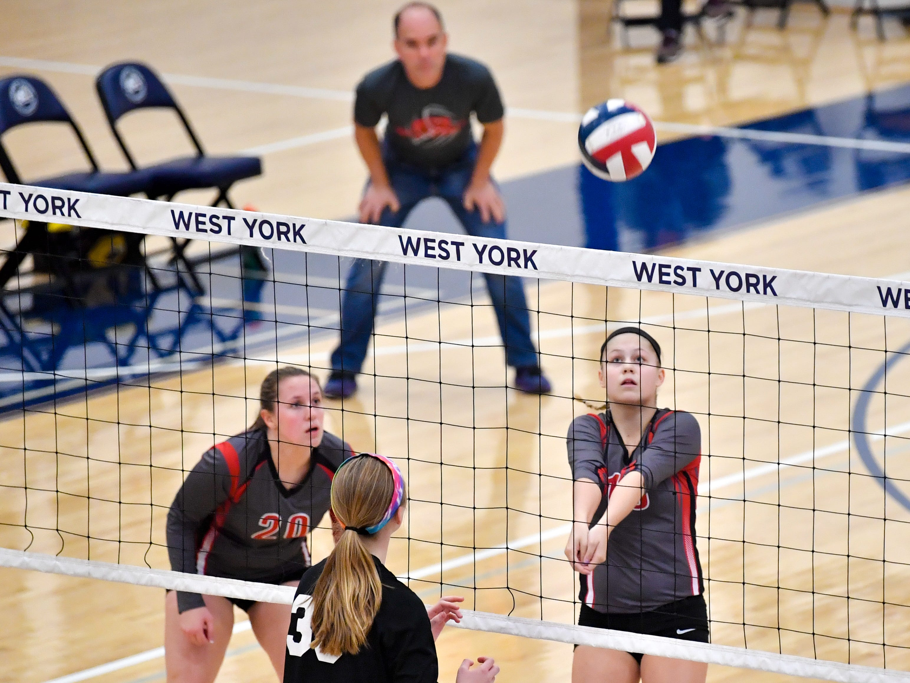 Abby Diehl (15) sends the ball over the net during the District 3 Class 3A girls' volleyball quarterfinals between Dover and York Suburban at West York High School, October 30, 2018. The Eagles defeated the Trojans 3-2.