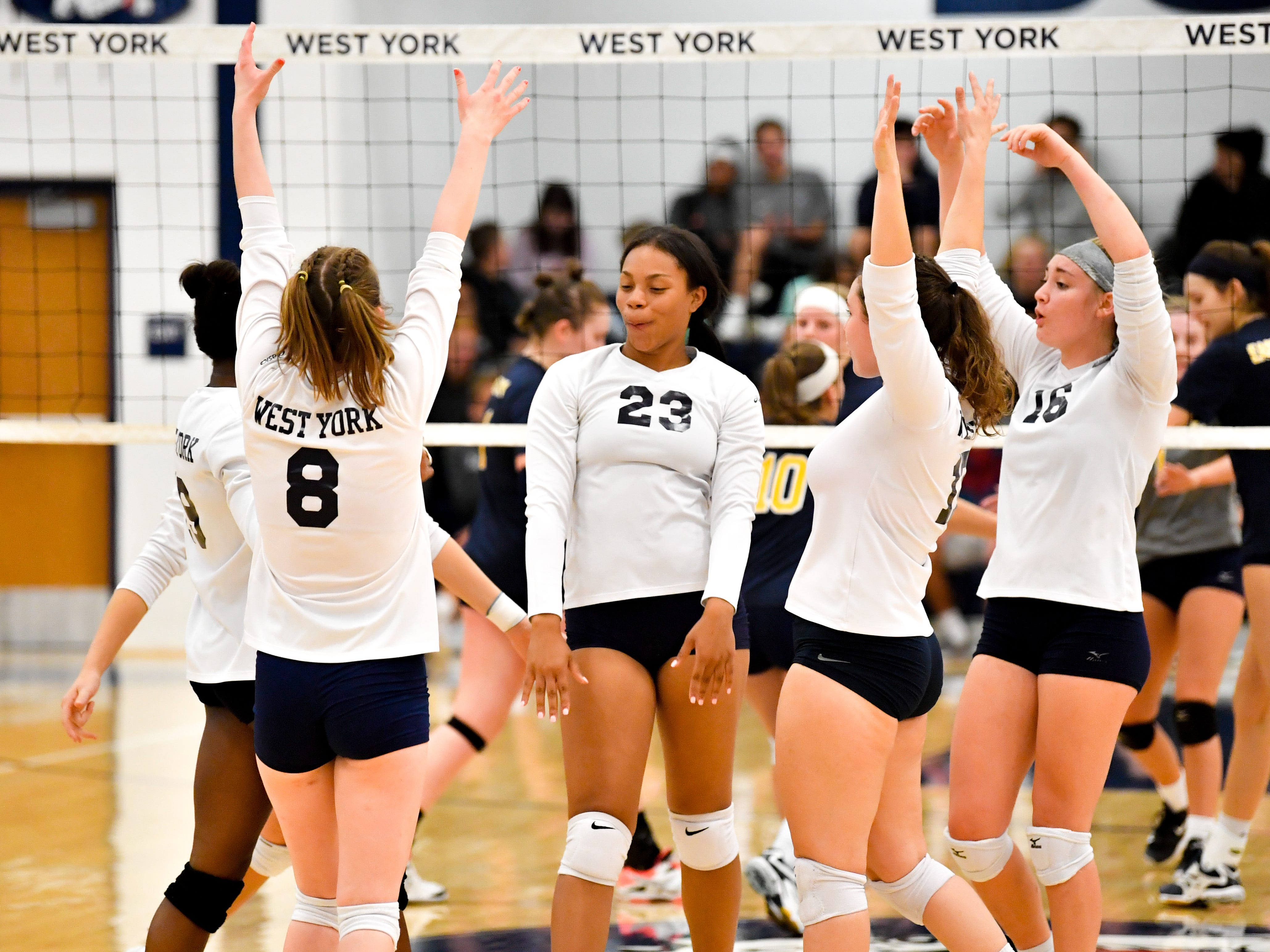 West York celebrates their block during the District 3 Class 3A girls' volleyball quarterfinals between West York and Eastern York at West York High School, October 30, 2018. The Bulldogs defeated the Golden Knights 3-0.
