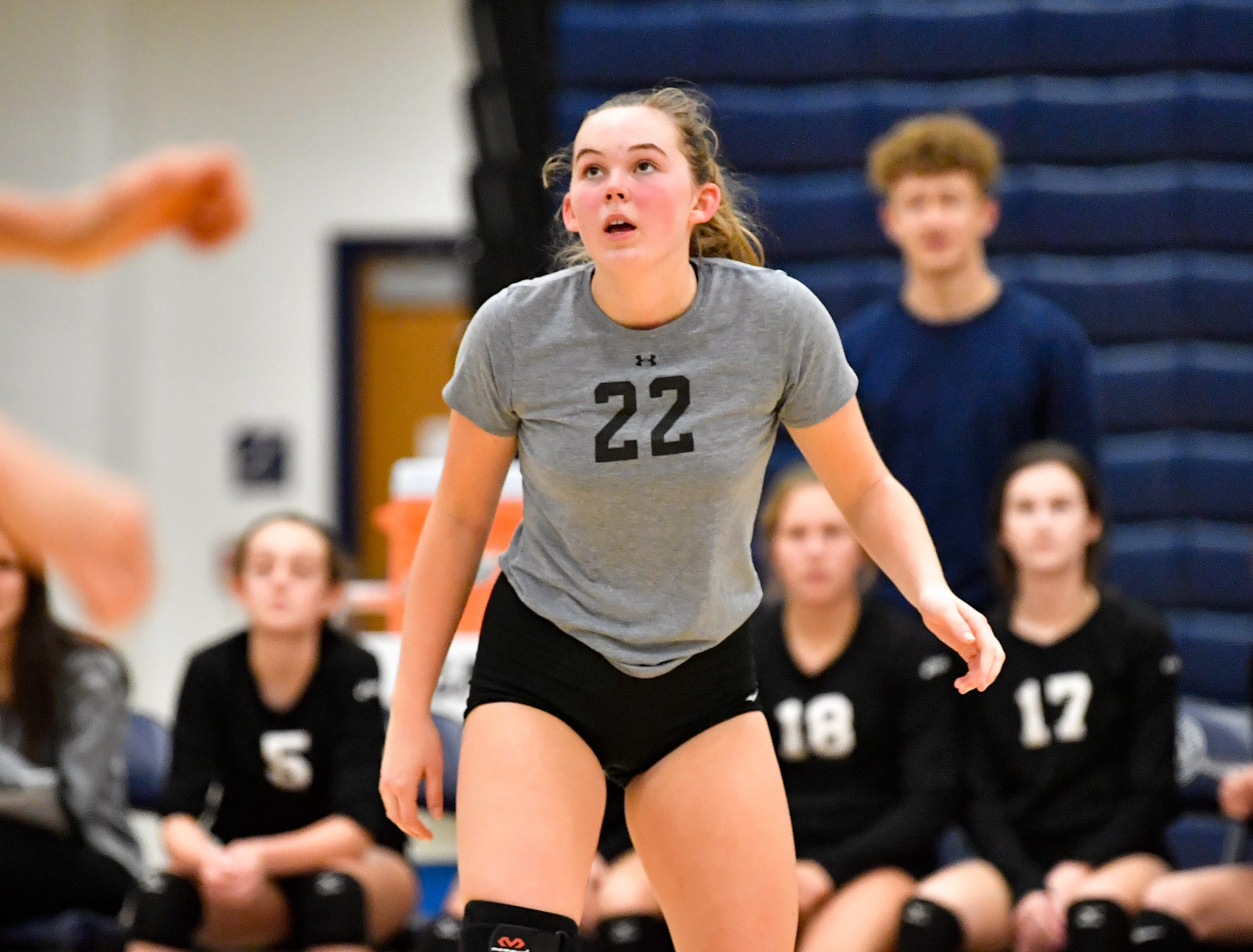Caitlin Springer (22) of York Suburban watches as the ball sails high into the air during the District 3 Class 3A girls' volleyball quarterfinals between Dover and York Suburban at West York High School, October 30, 2018. The Eagles defeated the Trojans 3-2.