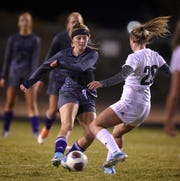 Spanish Springs' Allison Tullis gets the ball past Bishop Manogue's Kayla Snell in their regional playoff game at Spanish Springs on Tuesday. Spanish Springs won 2-1.