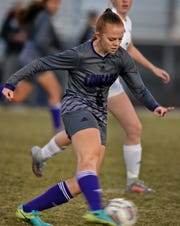 Spanish Springs' Charlotte Moreland moves the ball against Bishop Manogue in their regional playoff game at Spanish Springs on Tuesday. Spanish Springs won 2-1.