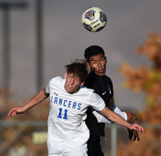 McQueen's Ethan Mahler and Galena's Jesus Medina Alvarez go up for a header during Monday's game at Galena.