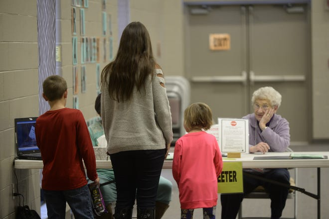 A family arrives at First English Lutheran Church on Wednesday, Oct. 31, 2018, to vote in the election.