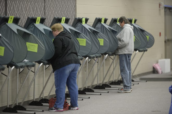 Voters cast their ballots on Wednesday, Oct. 31, 2018, at First English Lutheran Church in Richmond.