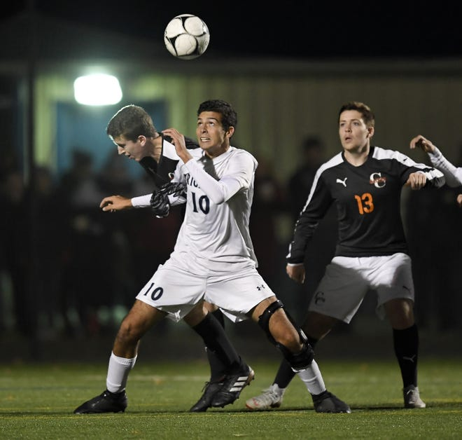 Brighton's Caio De Medeiros, center, heads home the game-winning goal with 1:44 left in overtime during the Section V Class A championship game at Spencerport High School, Tuesday, Oct. 30, 2018. Brighton claimed the Class A title with a 1-0 overtime win over Churchville-Chili.