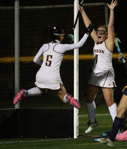 Pittsford Mendon's Ali Hess, right, celebrates her goal four minutes into the second overtime that gave the Vikings a 2-1 win over Pittsford Sutherland and their third straight Section V title.