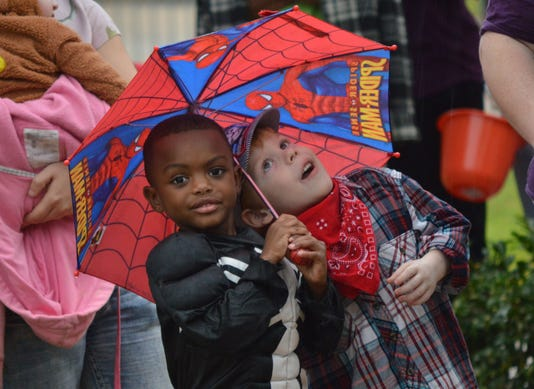 Ani Kees Park Halloween Phalan Williams Left Dressed As Dark Side Spider Man And Reece Aycock Dressed As A Train Conductor Take Shelter From The Rain Under A Spider Man Umbrella As They Wait To For The Pineville Fall Family Festival To Begin At Kees Pa