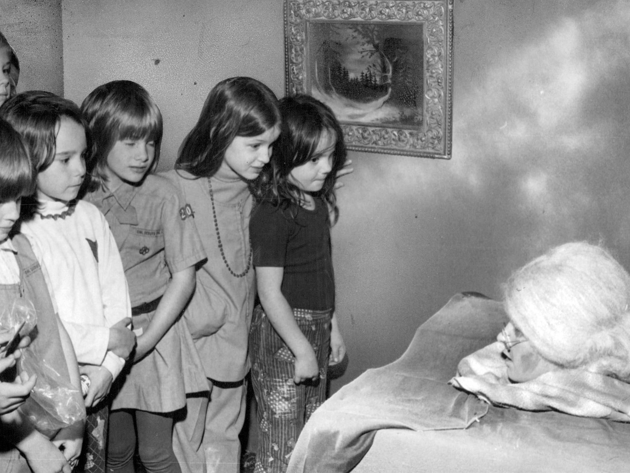 This photo from 1975 shows a group of youngsters going through a haunted house.