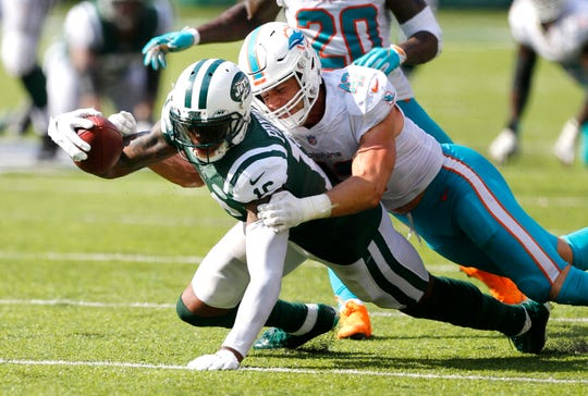 New York Jets wide receiver Terrelle Pryor (16) is tackled after a catch by Miami Dolphins linebacker Kiko Alonso (47).