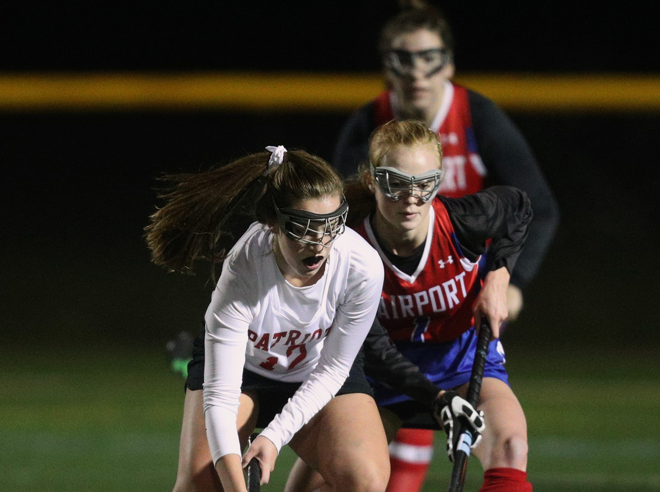 Fairport's Maggie Phipps comes from behind to pressure Penfield's Lindsey Hamilton.