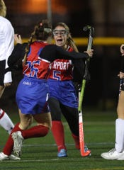 Fairport's Allison Belmont (5) celebrates a goal by teammate Kailynn Corey in the Class A final. The third-seeded Red Raiders stunned top-seeded and previously unbeaten Penfield 3-1.