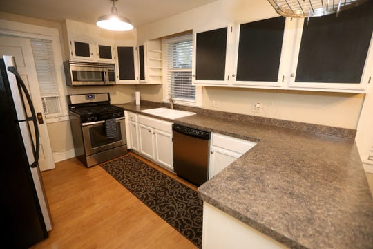 A spacious kitchen offers ample cooking space.